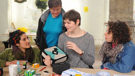 Elspeth Hart, 2nd right, teaching the art of making a pinhole camera at the Trade School, using the