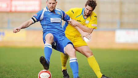 Lynn's Stuart Wall, right, on his return to action for Gary Setchell's side. Picture: Ian Burt