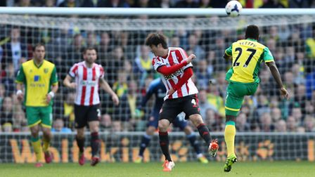 Norwich City's Alex Tettey unleashes his unstoppable 30-yard volley in the 2-0 Premier League win ov