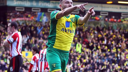 Robert Snodgrass of Norwich scores his sides 1st goal and celebrates during the Barclays Premier Lea
