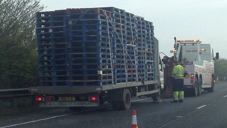 Broken down lorry blocking slow lane eastbound between Thickthorn and A140.