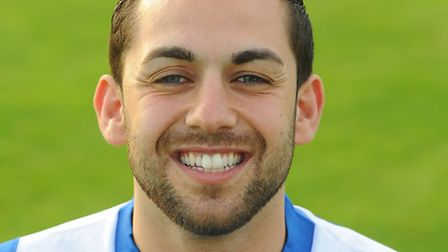 Erkan Okay is confident Lowestoft can still reach the play-offs.