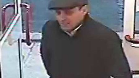 Police have released CCTV of a man they want to speak to in connection with a theft from a Diss car
