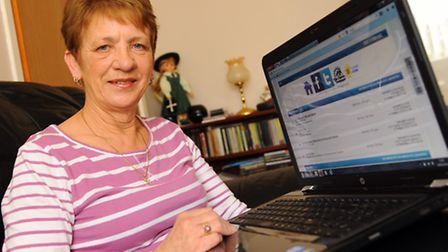 Maureen Oakes at home at Hethersett, with Chill 4 Us carers website on her laptop, her lifeline as s