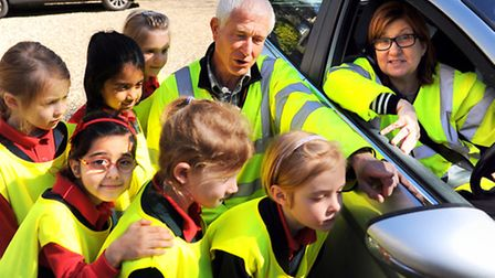 Children at the Norwich Infants School For Girls learn about car park and road safety. Martin Bull,