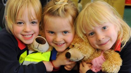 Children at the Norwich Infants School For Girls learn about car park and road safety. From left, Am