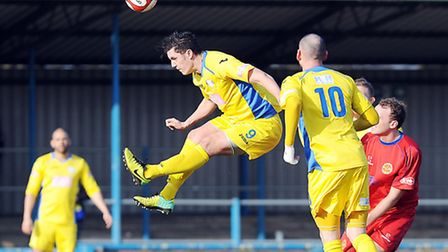 Action from King's Lynn Town v Skelmersdale at The Walks. Lynn's Jaosn Lee heads the ball. Picture: