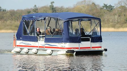 A new wheelchair accessible boat being launched at Fairhaven woodland and water garden.Picture: Jame