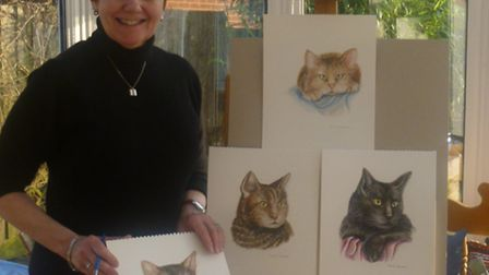 Pamela Dickerson with her artworks to tie in with the arrival of the musical Cats to Norwich Theatre