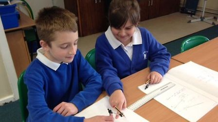 Year 5 pupils Andrew Burrell and Sophie Chambers working as partners to teach each other to accurate