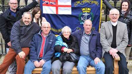 Ray Self's family gather around his memorial bench outside St Peter Mancroft church in Norwich. Phot