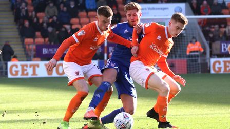 Teddy Bishop battles for the ball during Town's 2-1 defeat at Blackpool last seasonl Photo: ROSS HAL