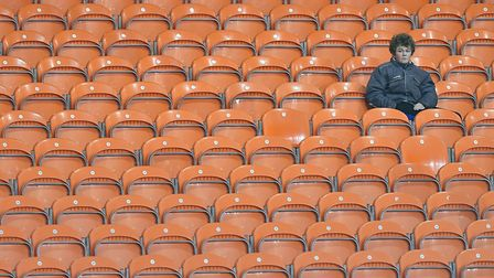 Rows of empty orange seats at Bloomfield Road. Picture: PA