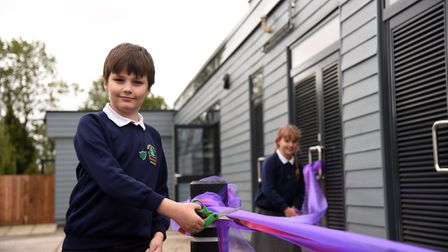 Billy and Mia cut the ribbon as Bildeston Primary School was reopened. Picture: CHARLOTTE BOND