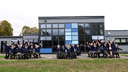 Pupils at Bildeston Primary School celebrate after the school was reopened following a renovation Pi