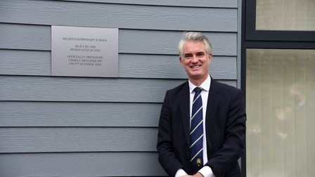MP James Cartledge revealed a plaque while reopening Bildeston Primary School after an 18-month refu