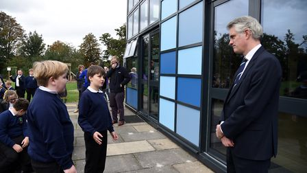 MP James Cartledge talking to Simon and Max after reopening Bildeston Primary School. Picture: CHARL