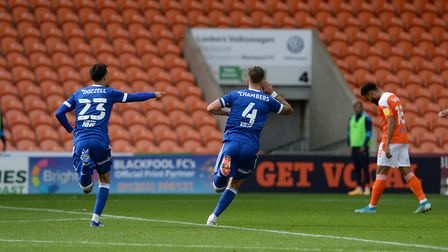 Luke Chambers celebrates his opening goal at Blackpool. Picture Pagepix Ltd