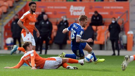 Teddy Bishop is fouled by Ethan Robson at Blackpool. Picture Pagepix Ltd