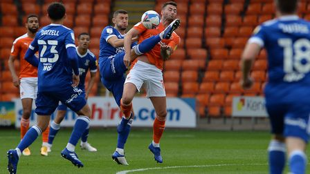James Wilson keeps very close to Gary Madine at Blackpool. Picture Pagepix Ltd