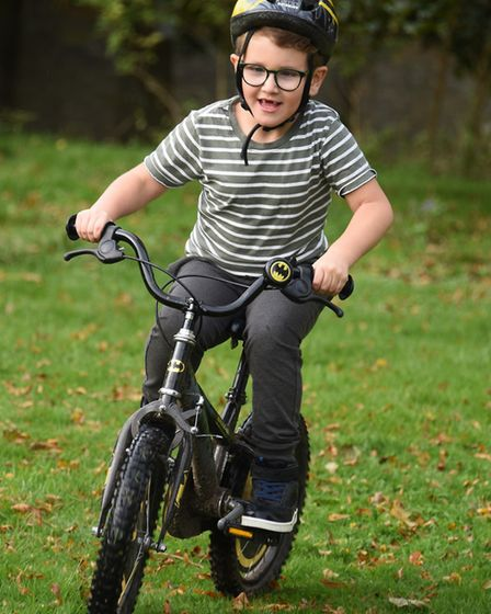 Harrison Gosling, six, cycling as he helps mum Natasha in training to raise funds for the Ectopic Pr