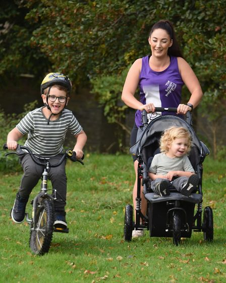 Natasha Gosling in training with her two sons, Harrison, six, and 22-month-old Jasper. She is runnin