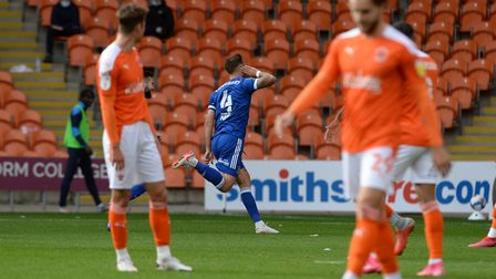 Luke Chambers celebrates after firing a searing shot on target to give Ipswich a first half lead at