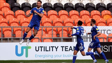 Luke Chambers celebrates his rocket of a goal which put Town ahead at Blackpool Picture: PA SPORT