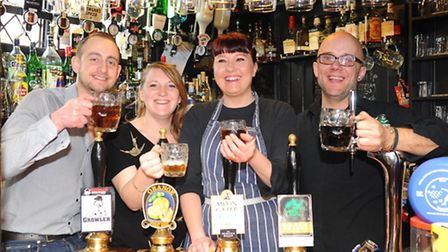 The Green Dragon in Wymondham has won CAMRA rural pub of the year.L-r manager, Nick Judge, Moya Tops