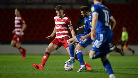 Gwion Edwards beats his man with some nifty footwork at Doncaster Rovers. Picture Pagepix Ltd