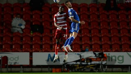Luke Chambers jumping high on his milestone appearance at Doncaster Rovers. Picture Pagepix Ltd