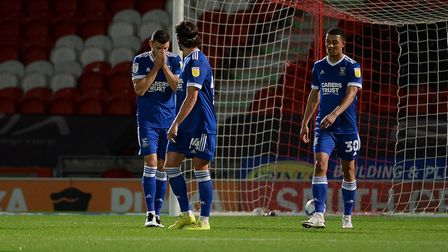James Wilson covers his face after Ipswich concede the second of two goal for the home side at Donca
