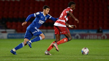 Andre Dozzell chases the ball at Doncaster Rovers. Picture Pagepix Ltd