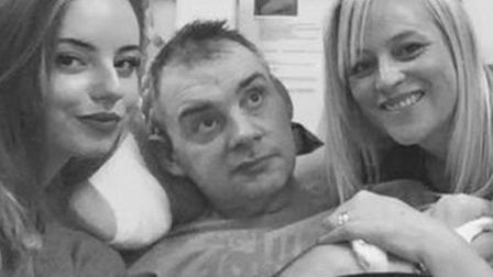 Simon Dobbin, pictured with his daughter Emily and wife Nicole Picture: FAMILY PHOTO