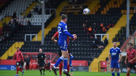 Oli Hawkins' towering first half header which was cleared off the line at Lincoln City. Picture Page