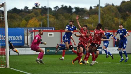 Gwion Edwards has a free header at Lincoln City but misses the target from within the six yard box.