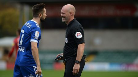 Referee Kevin Johnson talking to Gwion Edwards at Lincoln City. Picture: PAGEPIX LTD