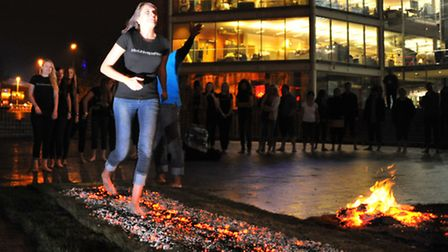 Miss Universe Norfolk competition models take part in a firewalk at The Forum in a bid to raise mone
