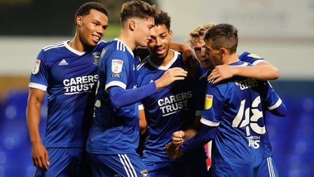 Town players celebrate with Ben Folami after his goal to take them 2-0 up. Picture: Steve Waller