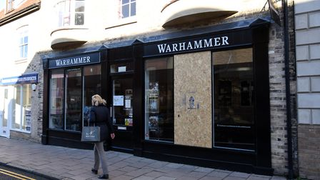 The window of the Warhammer shop in Bury St Edmunds has been boarded up after the break-in. Picture: