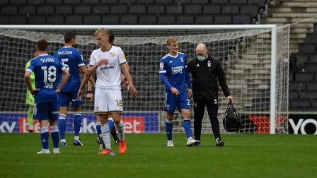 Flynn Downes goes off injured at MK Dons leaving Ipswich to manage with only ten men. Picture Pagepi
