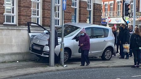 A car has mounted the kerb in Station Road, Clacton, between a lamp post and the Coral building. Pic