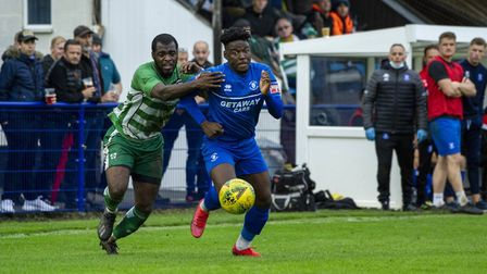 Bury Town substitute Cruise Nyadzayo shrugs off a challenge on his way to scoring the Blues' fourth