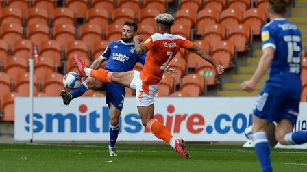 Gwion Edwards wins a corner off the challenge of Jordan Gabriel at Blackpool. Picture Pagepix Ltd