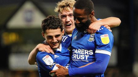 Janoi Donacien and Jack Lankaster celebrate with Armando Dobra, after he had scored to give Town a 1