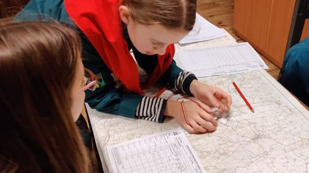 Scouts having a go at map reading Picture: 1ST FRESSINGFIELD SCOUTS