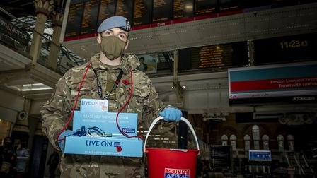 Members of 7 Battalion REME, 132 Aviation Support Squadron selling poppies at Liverpool Street stati