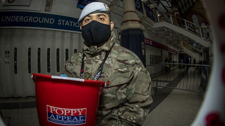 Private MD Ahmed from Royal Logistic Corps, 7 Battalion REME, 132 Aviation Support Squadron selling
