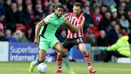 Mikael Mandron, left, seen here playing for Colchester, is Crewe's leading scorer so far this season