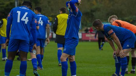 Bury Town players look dejected after the final whistle sounds at Banbury United during last weekend